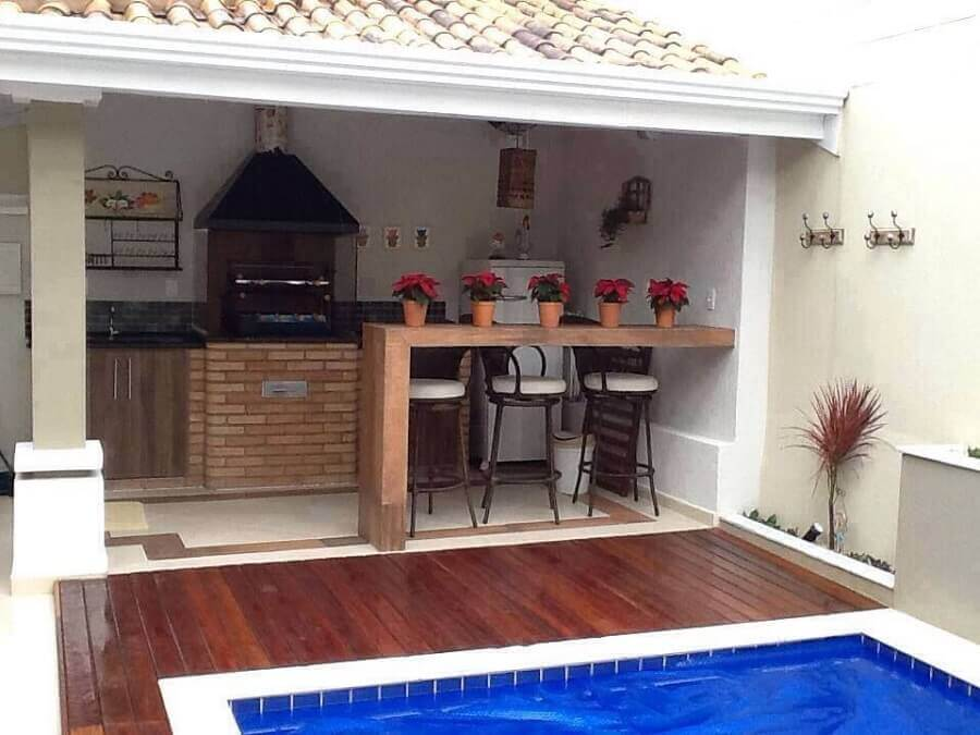 decoração simples para área gourmet pequena externa com piscina Foto Pinterest