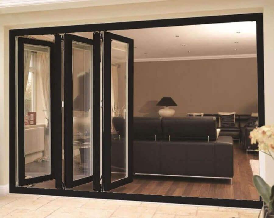 modelo camarão de porta para sala decorada com sofá preto Foto Pinterest