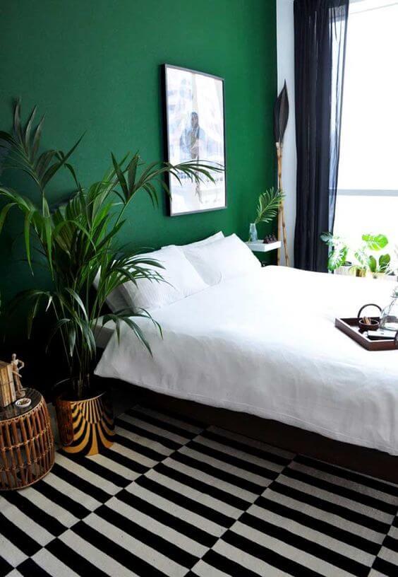 Parede verde esmeralda para o quarto moderno