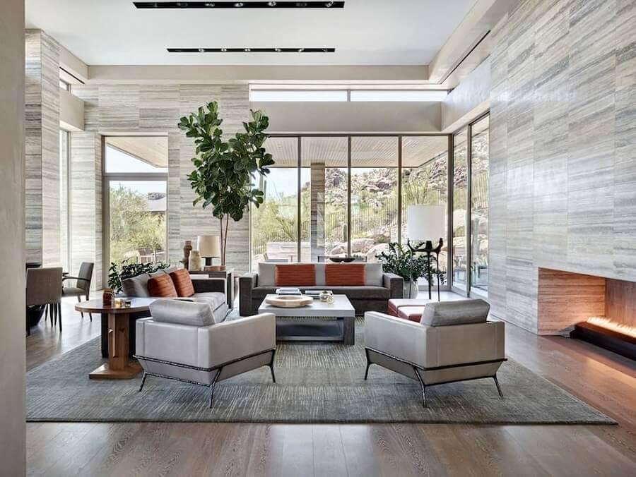 sala de casas de luxo decorada com lareira Foto Archinect