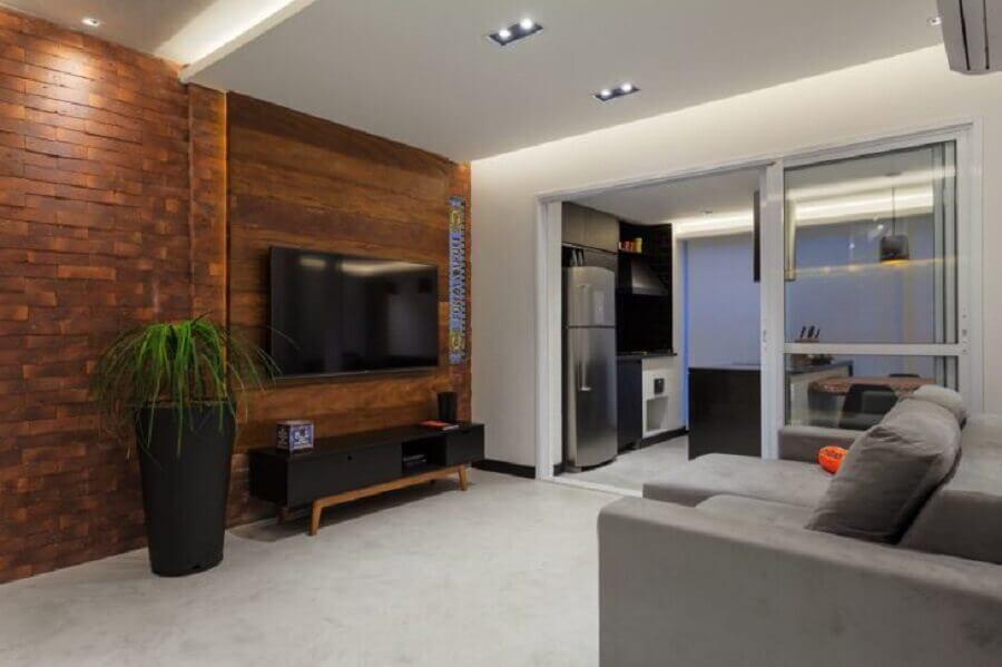 separação de cozinha com porta de correr para sala Foto Raduan Arquitetura & Interiores