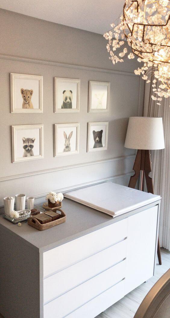Decoração fofa com quadros para quarto de bebê que retratam a imagem de animais. Fonte: Olinto Design