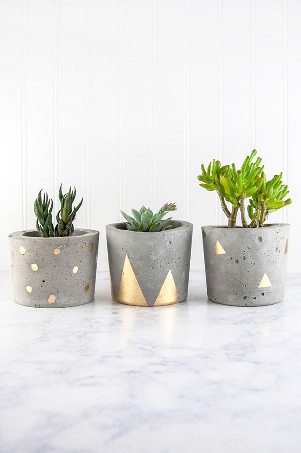 Vasos para suculentas de cimento decorados