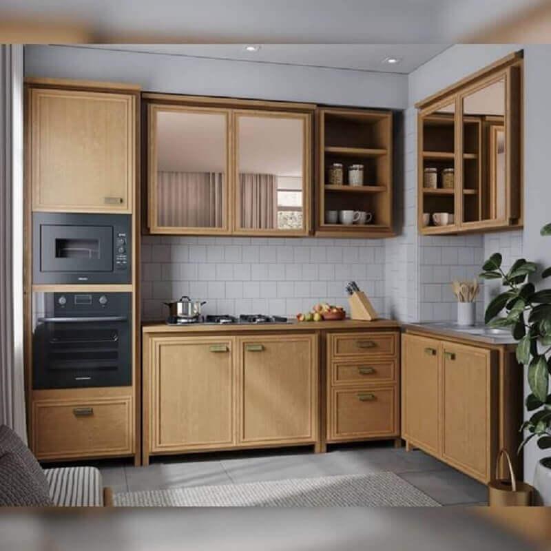 cozinha modulada com armários de madeira Foto Iaza