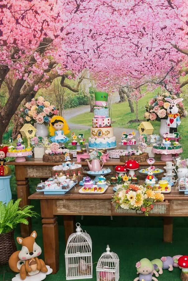 alice party decoration in wonderland with rustic tables and flower panel Photo Latest Decoration