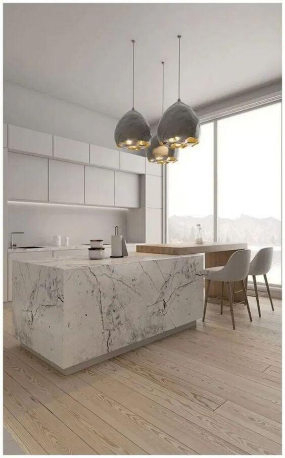 Lustre para cozinha combinando com o mármore do balcão