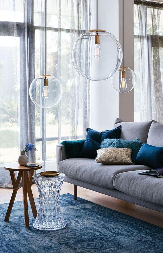 Aposte no lustre redondo para salas modernas