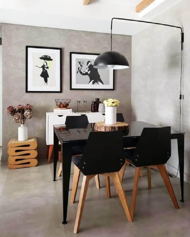 mesa com cadeira preta para sala de jantar moderna com parede de cimento queimado Foto Pinterest