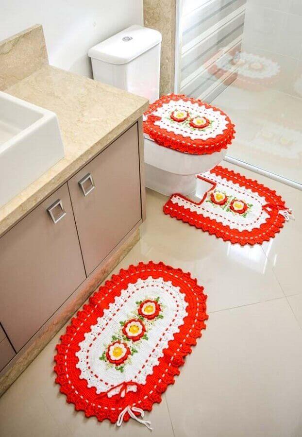 modelo de jogo de banheiro com flores de crochê laranja e bege Foto Pinterest