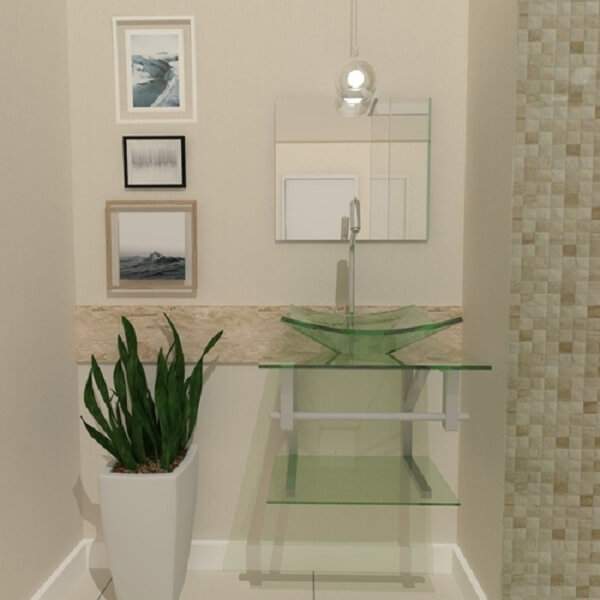 pia de banheiro de vidro e gabinete