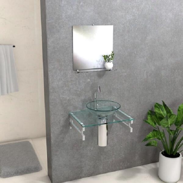 pia de banheiro de vidro gabinete e espelho