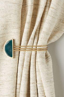 Prendedor de cortina azul e dourado