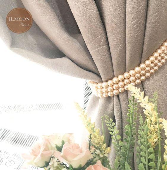 Prendedor de cortina feito de pérolas