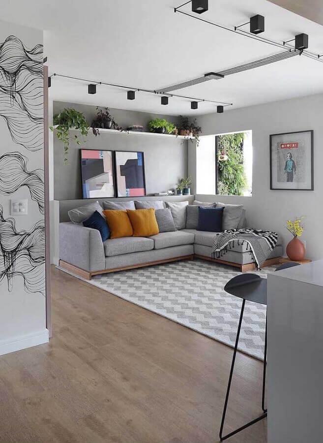quadros decorativos abstratos coloridos para decoração de sala cinza com sofá com chaise Foto Futurist Architecture