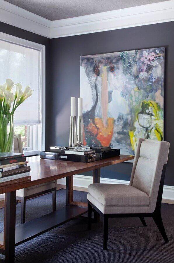 sala de jantar moderna decorada com quadro abstrato grande e colorido Foto Archidea