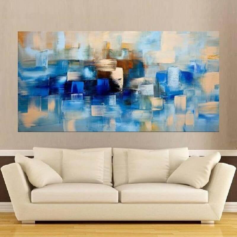 sala decorada com quadro abstrato azul Foto Pinterest