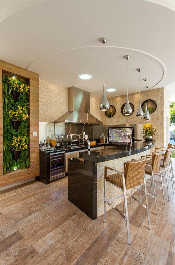 Área gourmet com churrasqueira moderna de inox