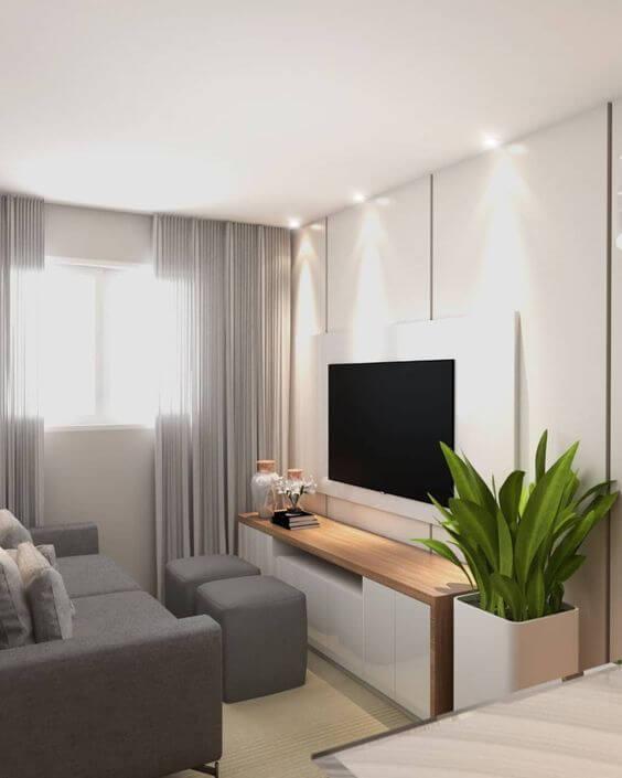 Sala de estar com cortineiro embutido