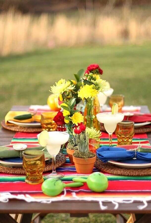 Outdoor Mexican party decoration with flower pots and plants Photo Catch My Party