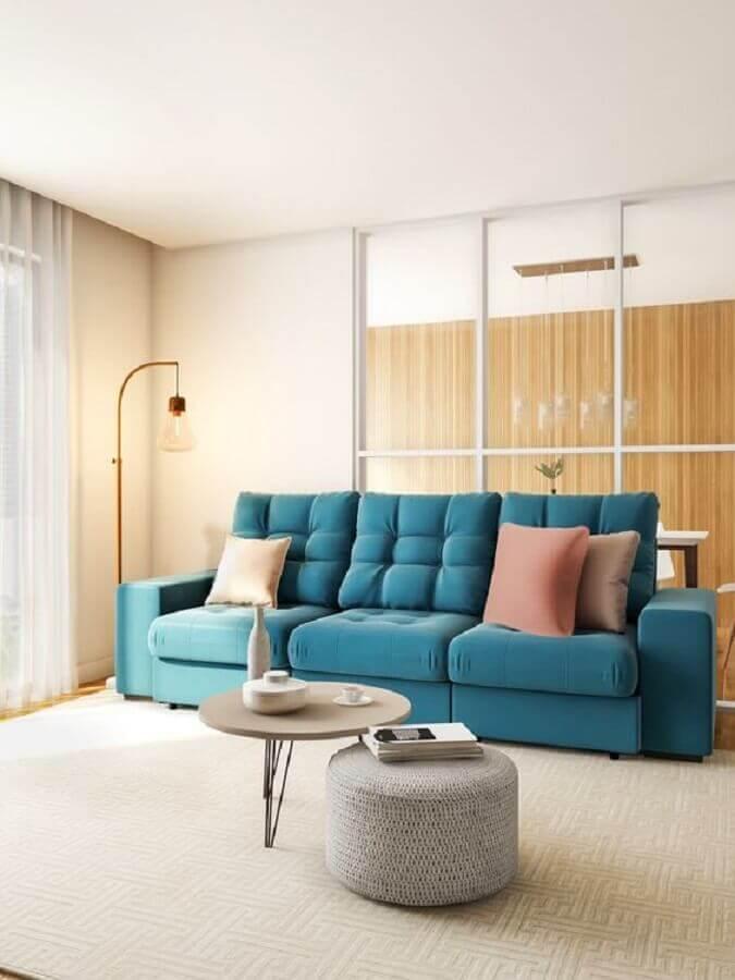 decoração minimalista para sala com sofá azul Foto Pinterest