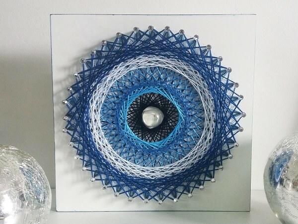 Afaste a energia negativa do ambiente usando o quadro string art mandala olho grego