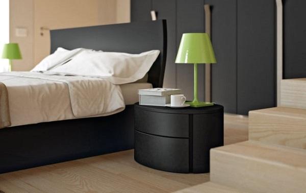Criado mudo redondo com gavetos em tom preto