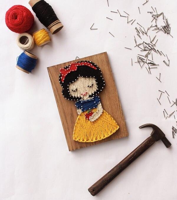 Decore o quarto infantil com um quadro string art da Branca de Neve