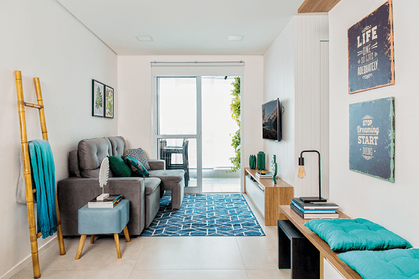 On the sofa, folding the little gray if you connect to the decor in the living room