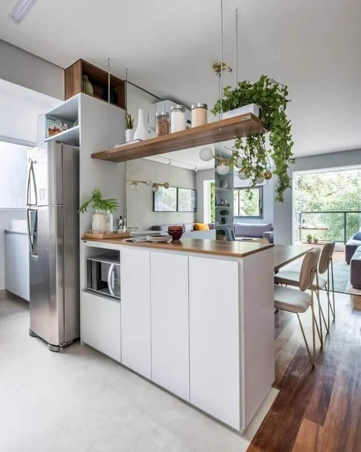 decoração clean com prateleira suspensa cozinha Foto SP Estúdio