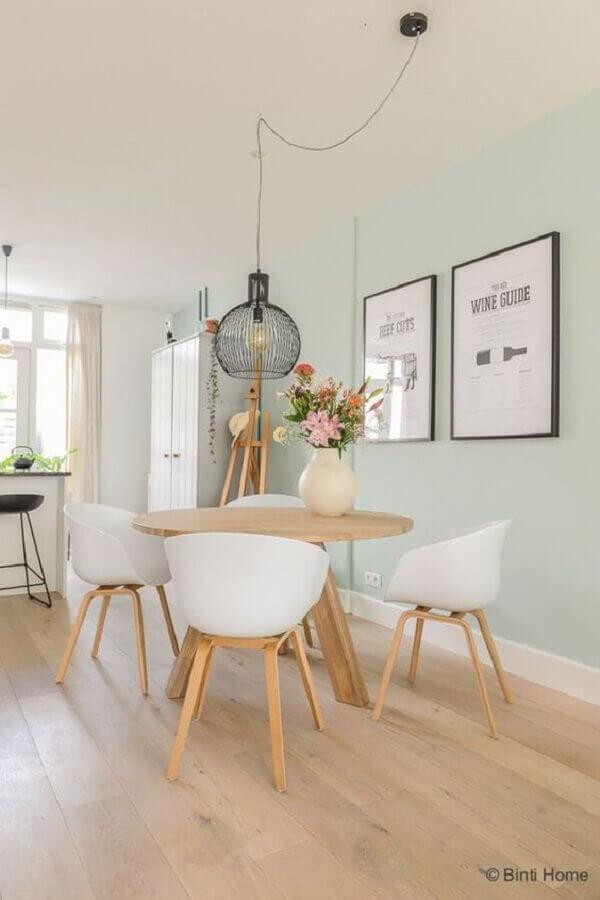 decoração clean para sala de jantar com vaso de flor para mesa de jantar Foto Fashionismo