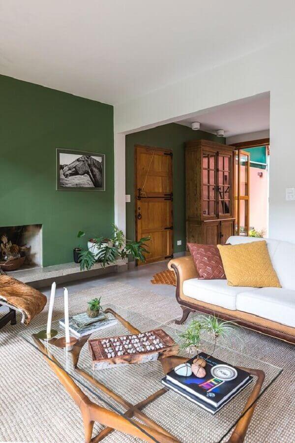 decoração de sala verde com lareira Foto Casa de Valentina