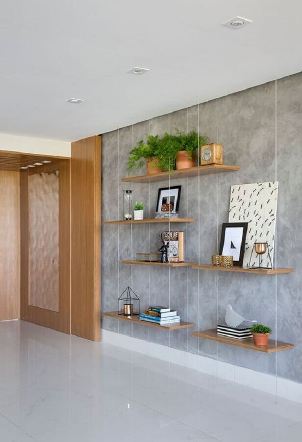 decoração para parede de cimento queimado com prateleira suspensa Foto Casa de Valentina
