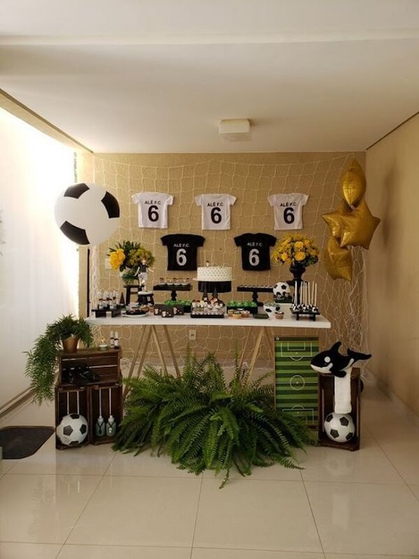 Custom T-shirts can complement the soccer-themed party decoration