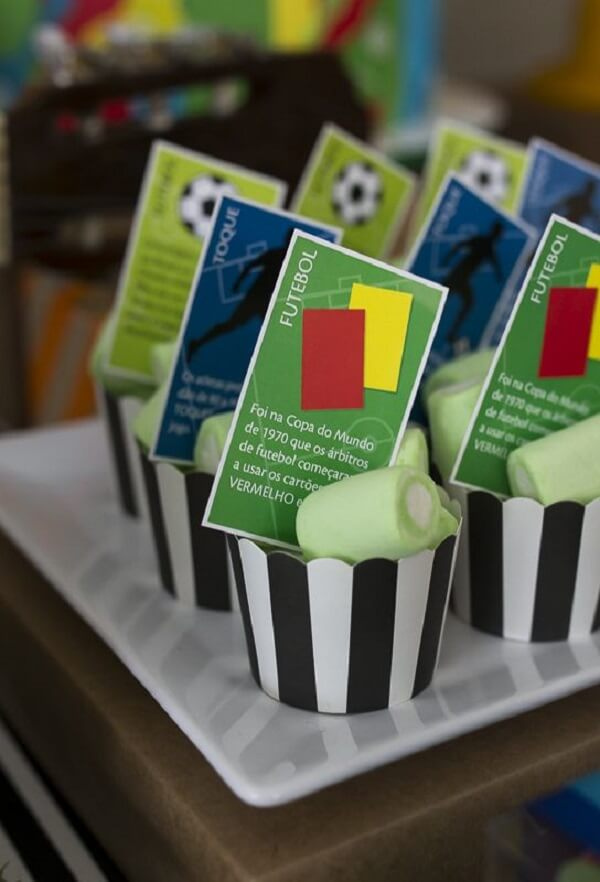 Creative cards decorate the football theme party candies
