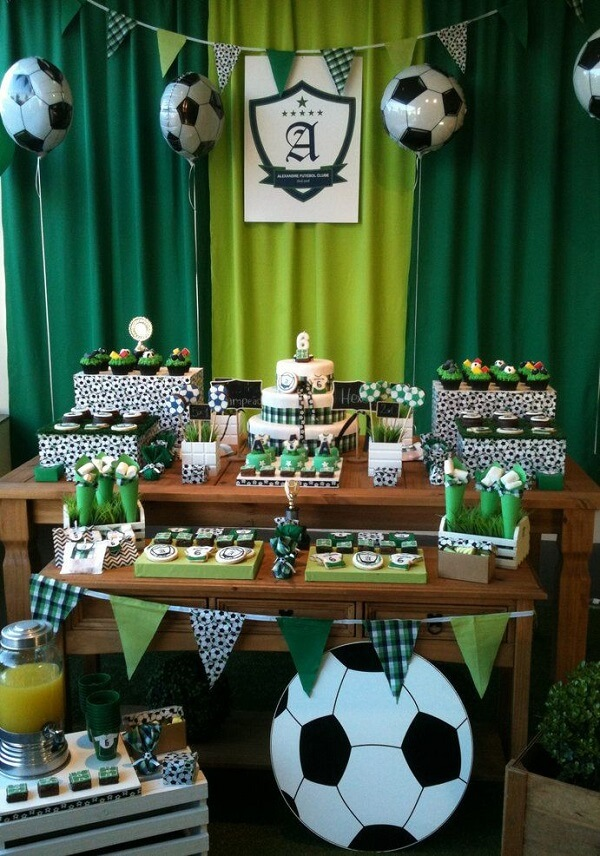 Fabric curtain complements the decoration of the football theme party