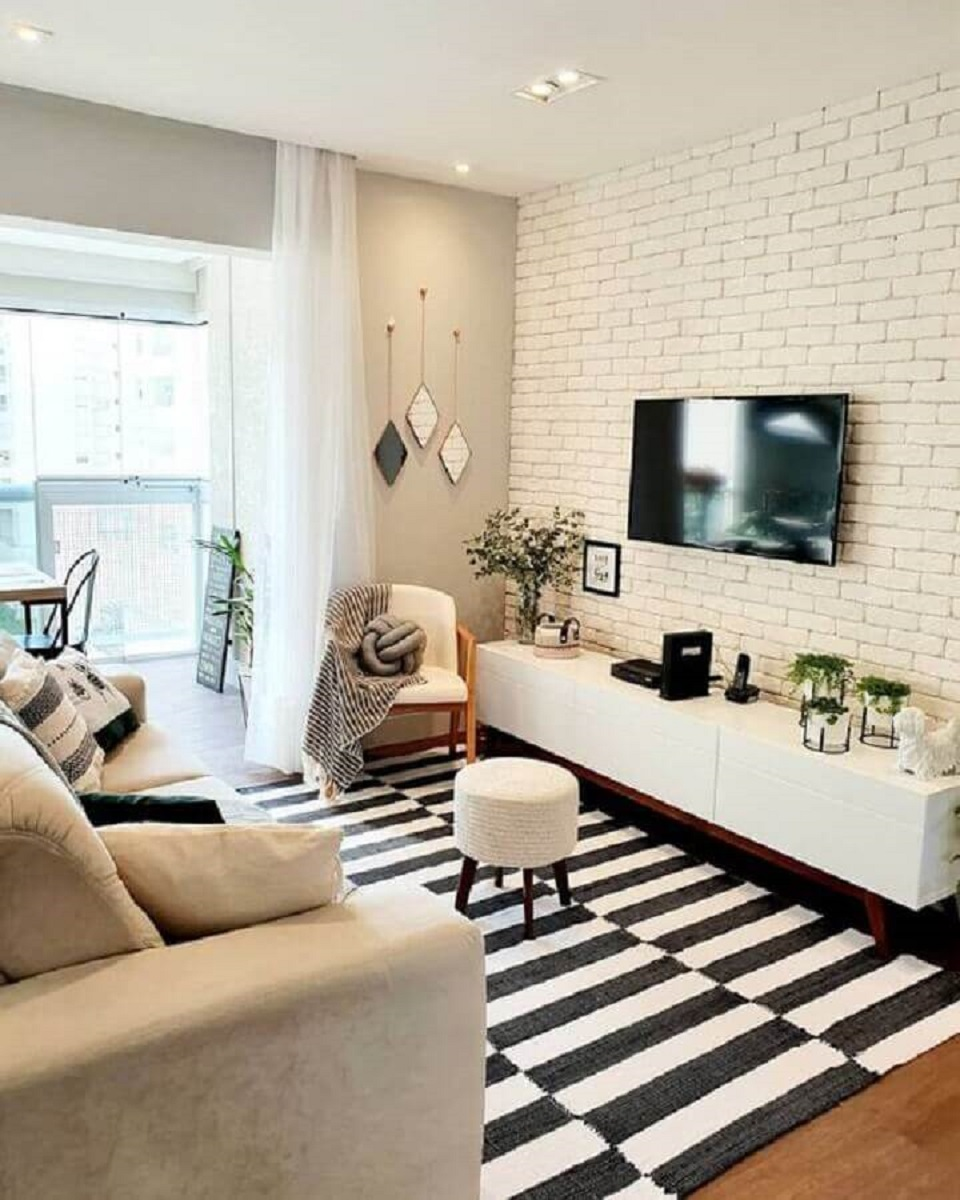 Decorated with a striped rug and wallpaper for living room-TV-print-of-brick-white-Photo Pinterest