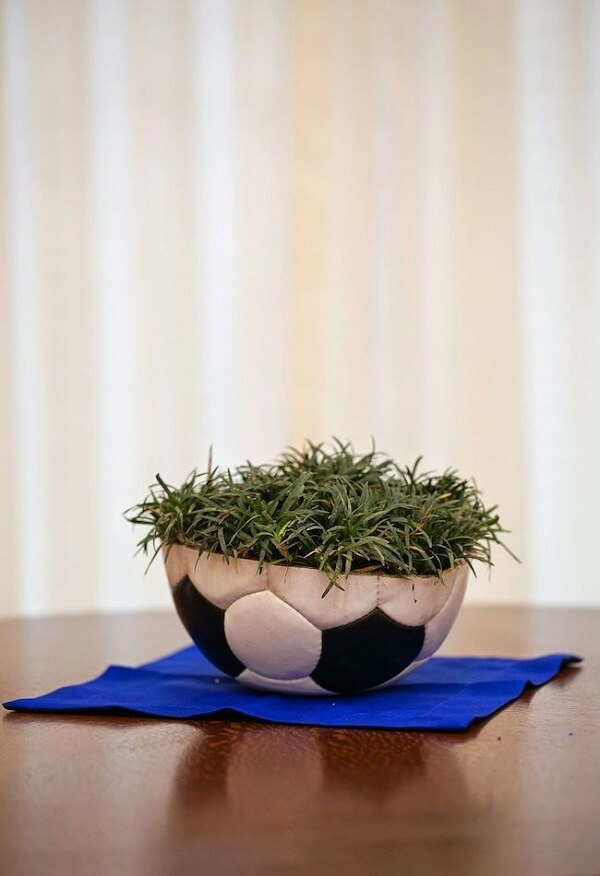 Tabletop decoration with ball and grass for football theme birthday party
