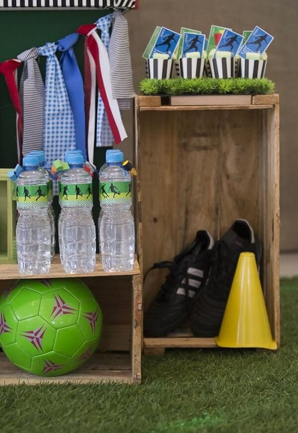 Wooden crates complement the football theme party decoration