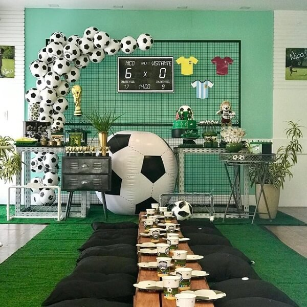 Gather the children of the party theme football at a single table