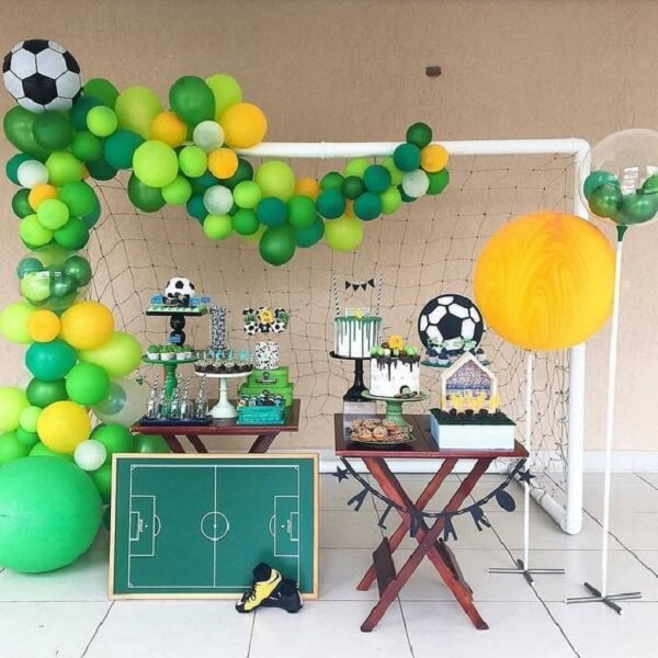 Use a goalpost to set up the football-themed party decoration
