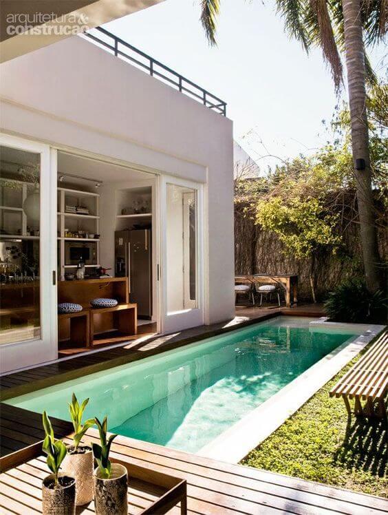 Área gourmet com piscina na casa moderna