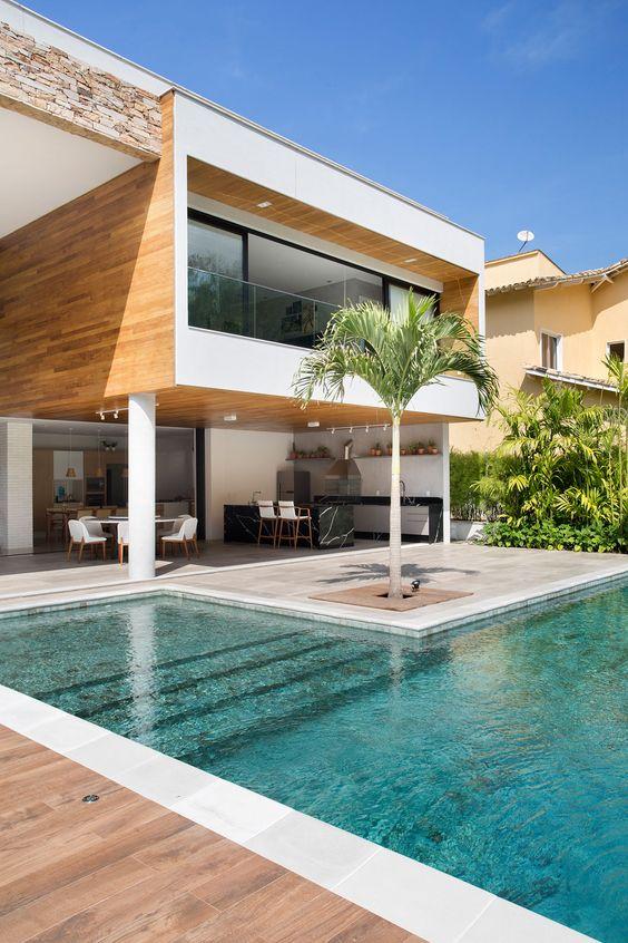 Área gourmet com piscina e churrasqueira