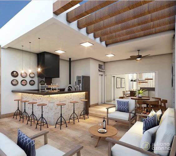 Área gourmet bem decorada com móveis modernas