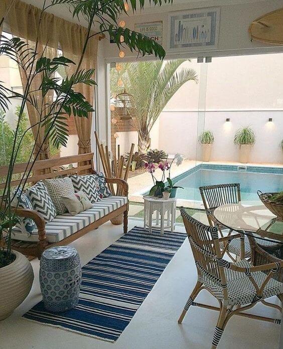 Área gourmet confortável com piscina moderno