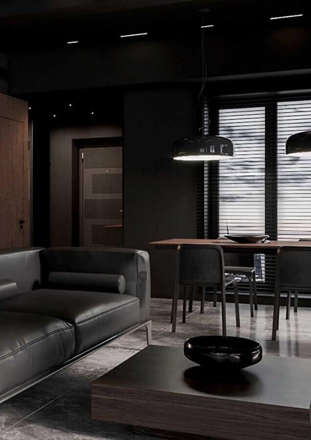 piso de cimento queimado e sofá de couro para decoração de sala preta Foto Home Fashion Trend