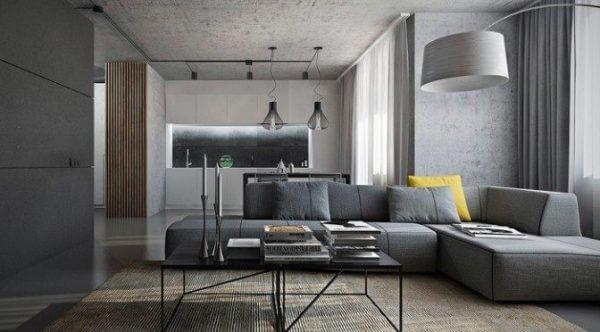 Apenas uma almofada amarela pode fazer toda diferença sobre o sofá de canto cinza
