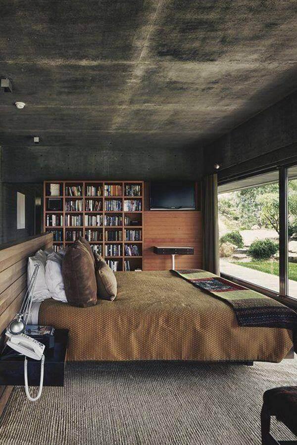 Quarto masculino moderno decorado com estante de madeira para livros Foto Futurist Architecture