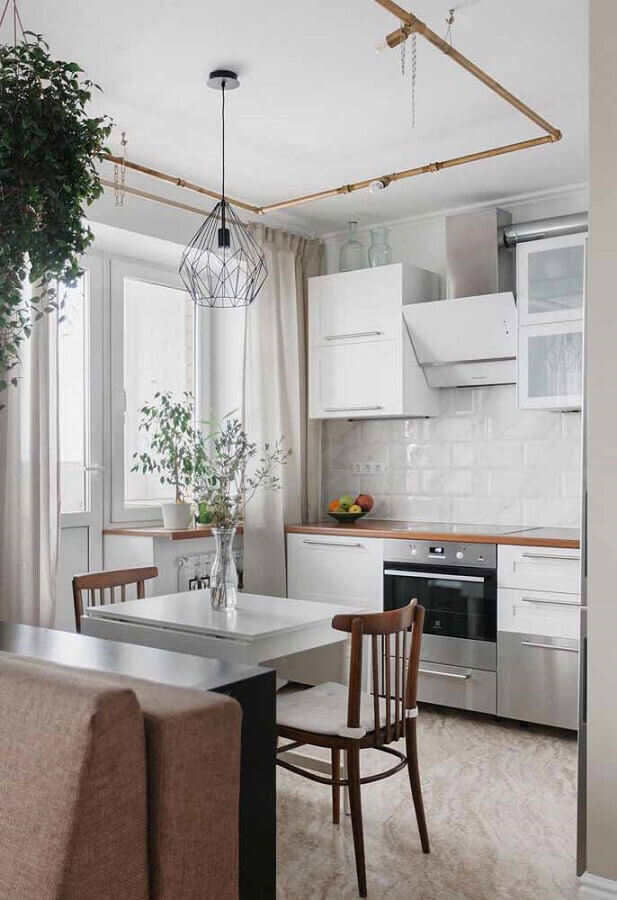 armário de cozinha pequeno branco com bancada de madeira Foto Apartment Therapy