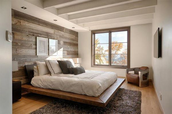 Cama flutuante no quarto moderno com poltrona