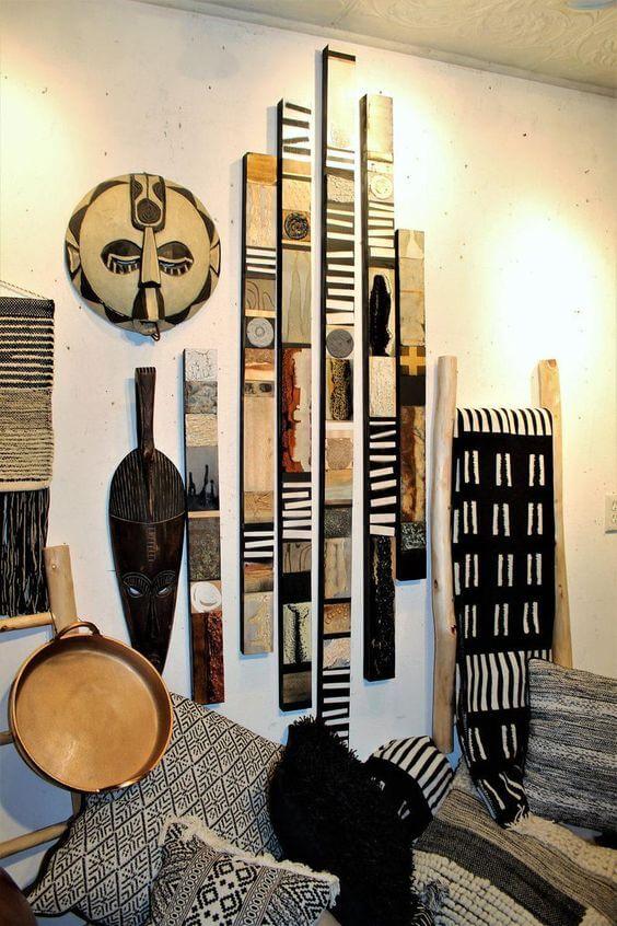 Quadros e máscaras africanas tradicionais na decoração de casa